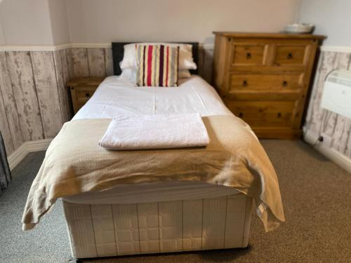 A bed or beds in a room at Stanley Arms