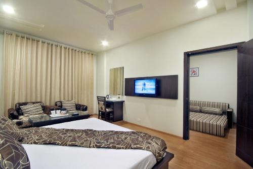 A bed or beds in a room at Best Western Swing High Katra