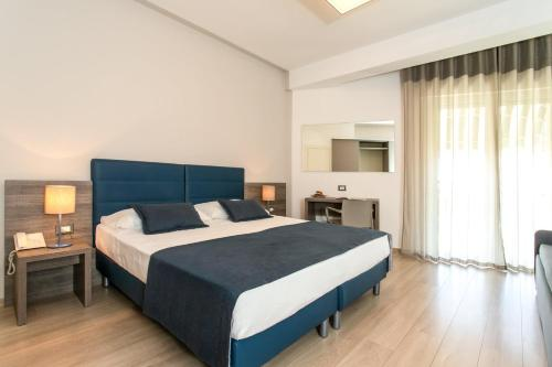 A bed or beds in a room at Hotel Delle Mimose