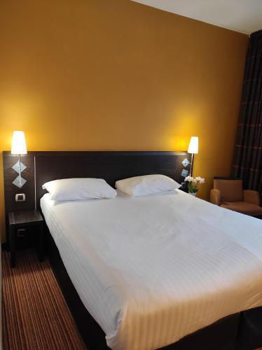 Un ou plusieurs lits dans un hébergement de l'établissement ibis Styles Metz Centre Gare