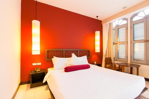 A bed or beds in a room at The Memory at On On Hotel - SHA Plus