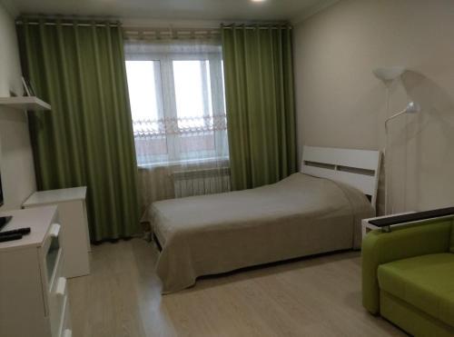 Кровать или кровати в номере Апартаменты на Ленина 130