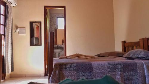 Cama ou camas em um quarto em Pousada Recantos dos Mineiros