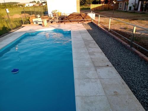 The swimming pool at or near El Amanecer Hospedaje