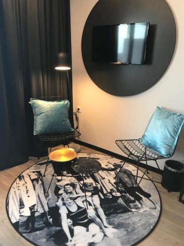 Een TV en/of entertainmentcenter bij Palace Hotel Zandvoort