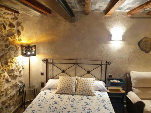 Cama o camas de una habitación en Hotel La Beltraneja