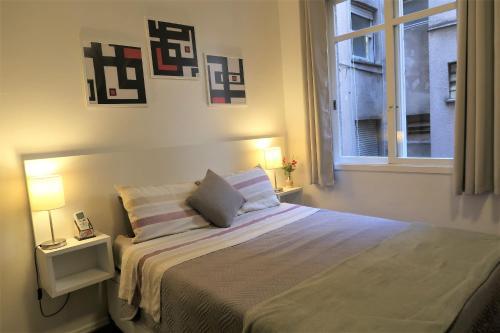 Cama ou camas em um quarto em Lugar todo no Centro I-Próx. a Santa Casa e UFRGS