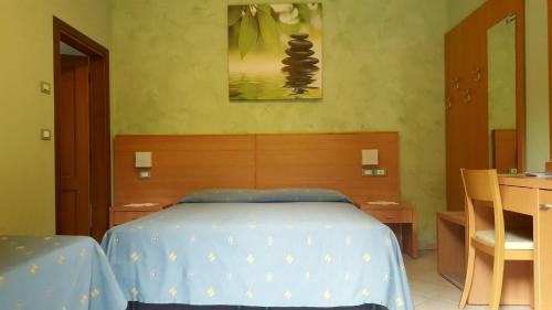 Letto o letti in una camera di B&B ENSILEVA BEACH