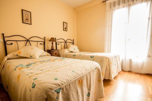 Cama o camas de una habitación en Hotel Rural El Paraiso de Gredos
