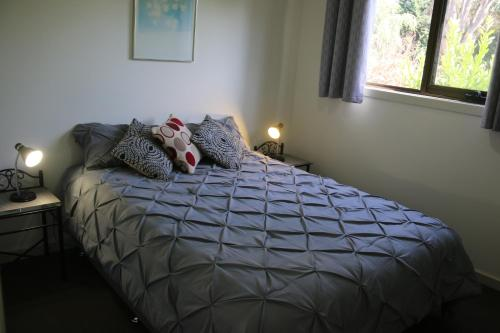 A bed or beds in a room at Altona Garden Retreat