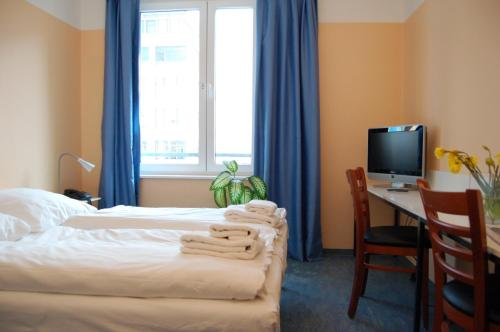 A bed or beds in a room at Pegasus Hostel Berlin