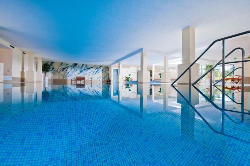 The swimming pool at or near Sporthotel & Resort Grafenwald Daun - Vulkaneifel