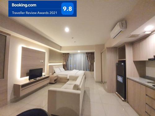 A seating area at Apartemen Grand Kamala Lagoon Studio By Bonzela Property