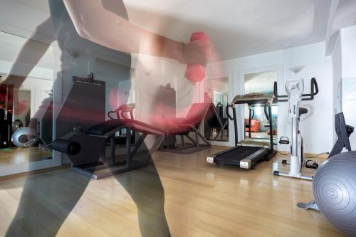 The fitness center and/or fitness facilities at Aegean Suites Hotel