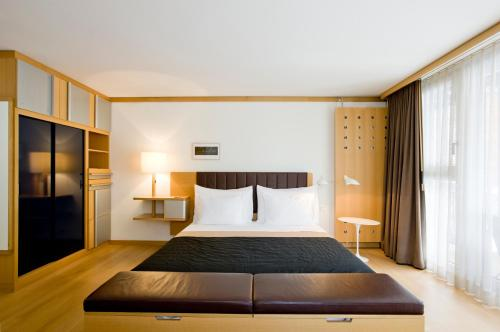 A bed or beds in a room at The Omnia