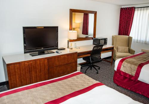 A television and/or entertainment center at Ramada by Wyndham Cedar City