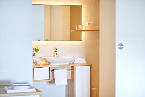 A bathroom at Pierspeicher Boutique Hotel