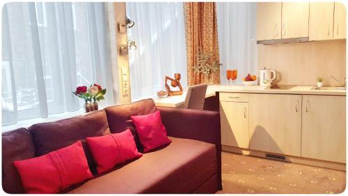 A kitchen or kitchenette at Vivulskio Apart-Hotel