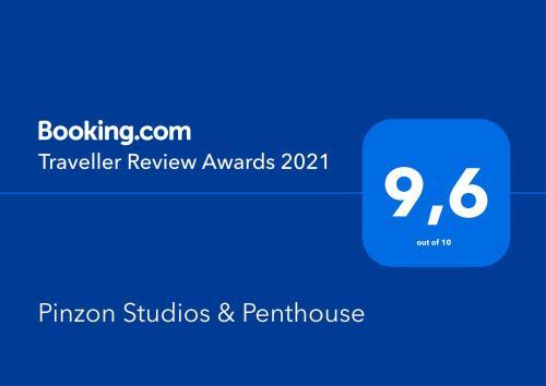 Certificado, premio, señal o documento que está expuesto en Pinzon Studios & Penthouse