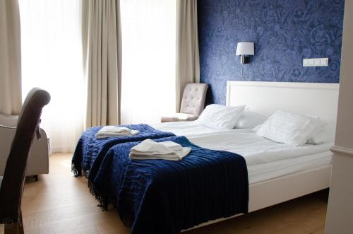 A bed or beds in a room at Hotel Villa Baltica