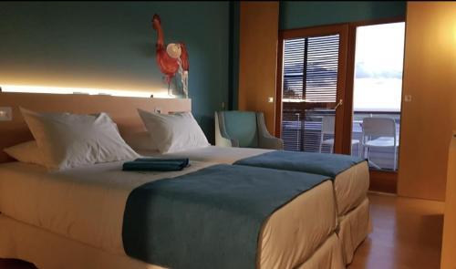 Cama o camas de una habitación en Hotel Ritual El Palmar-Adults Only