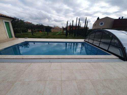 The swimming pool at or near Villen Matija & Mima