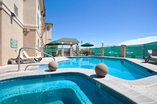 The swimming pool at or near Country Inn & Suites by Radisson, Tucson City Center, AZ