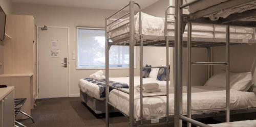 A bunk bed or bunk beds in a room at Leumeah Lodge