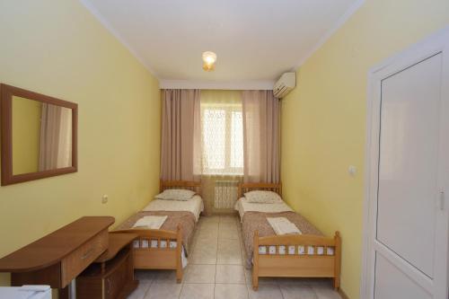 Кровать или кровати в номере Гостевой Дом Натела