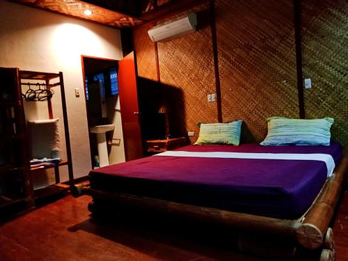 A bed or beds in a room at Allba's Homestay