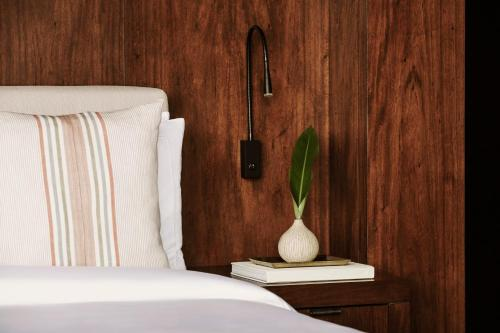 A bed or beds in a room at One&Only Mandarina