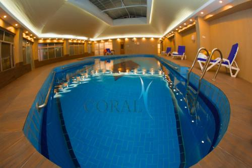 The swimming pool at or near Coral Palace Hotel