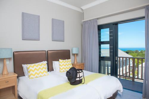 A bed or beds in a room at Brenton Haven Beachfront Resort