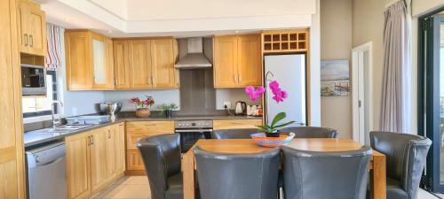 A kitchen or kitchenette at Brenton Haven Beachfront Resort