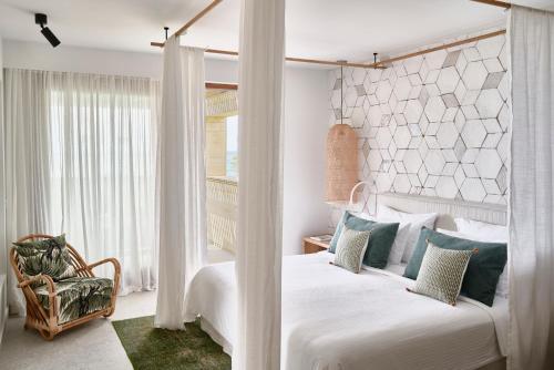 Кровать или кровати в номере Cretan Malia Park a Member of Design Hotels