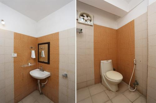 A bathroom at OYO 10685 Hotel Centre Point
