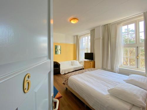 Un ou plusieurs lits dans un hébergement de l'établissement Landgoed Huize Glory
