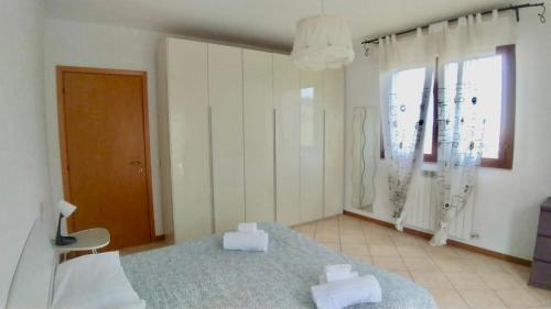 A bed or beds in a room at Residenza Cleopatra 4