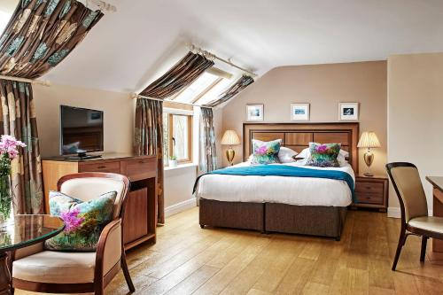A bed or beds in a room at Greenmount House
