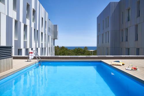 The swimming pool at or near Lugaris Beach