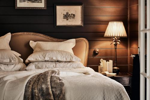 A bed or beds in a room at The Blackwood Sassafras