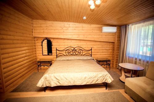 Кровать или кровати в номере Resort Forelka