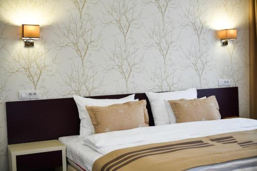 Ein Bett oder Betten in einem Zimmer der Unterkunft Hotel Zepter Palace