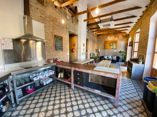 A kitchen or kitchenette at ECO Hostel