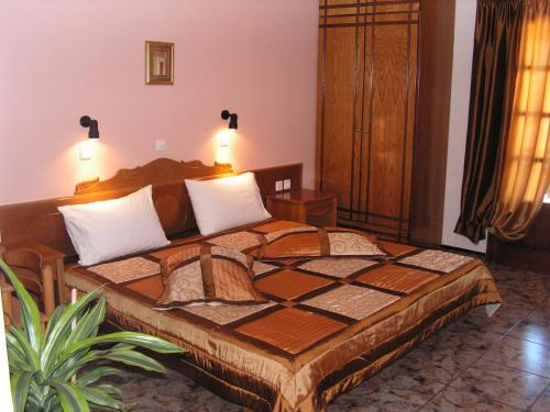 A bed or beds in a room at Aphroditi Hotel