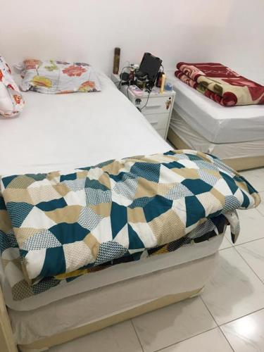 A bed or beds in a room at Ladies single bedspace in front of Karama Center!