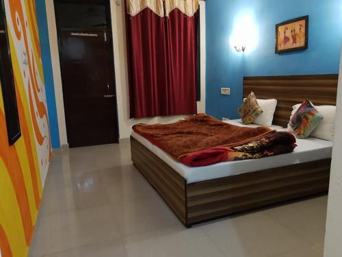 Cama o camas de una habitación en La Vaca India McLeodganj