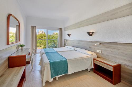 Letto o letti in una camera di Apartamentos Ben-Hur