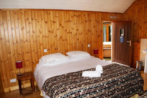 A bed or beds in a room at The Bothy