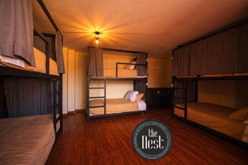 A bunk bed or bunk beds in a room at The Nest La Paz